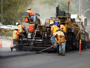 Paving company working on commercial paving job